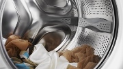 под барабан стиральной машины попал предмет