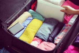 як скласти речі в чемодан